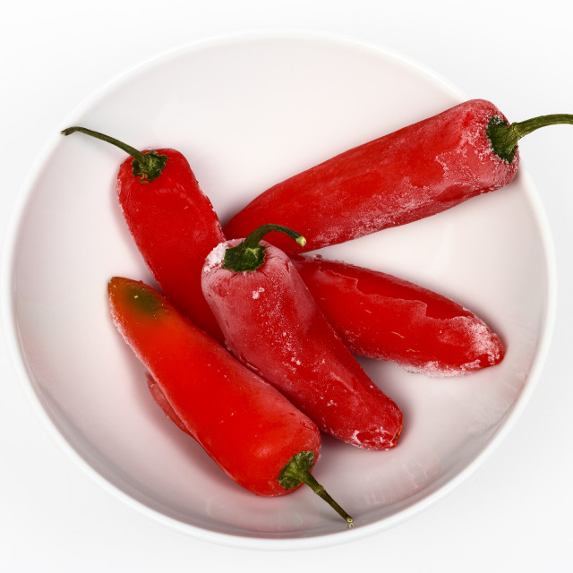 """Bowl of frozen red peppers in a bowl"" stock image"