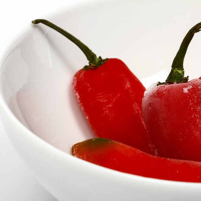 """Bowl of frozen red chilli peppers in a bowl"" stock image"