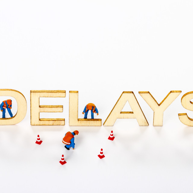 """Wooden delays sign with miniature figure workmen"" stock image"