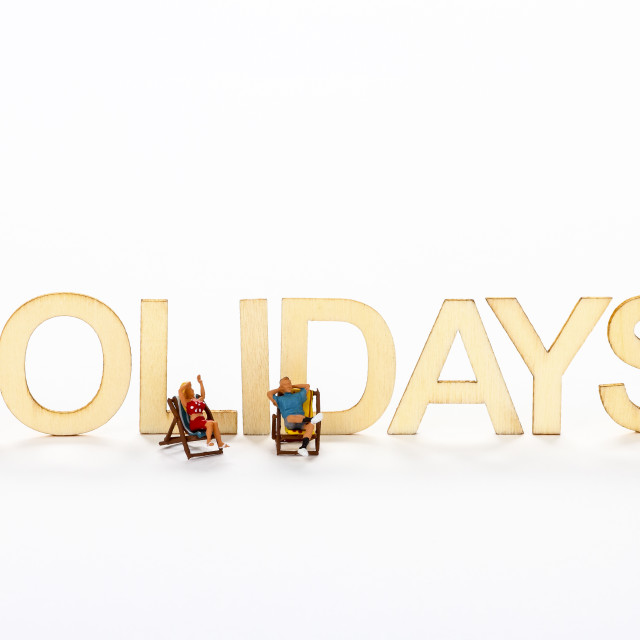 """Wooden holiday sign with miniature figure people"" stock image"
