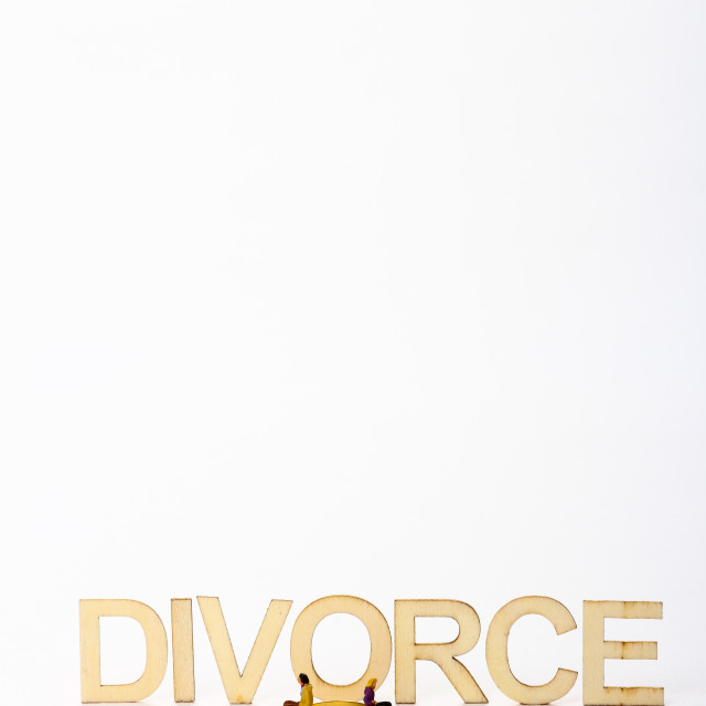 """Wooden divorce sign with miniature figure couple"" stock image"