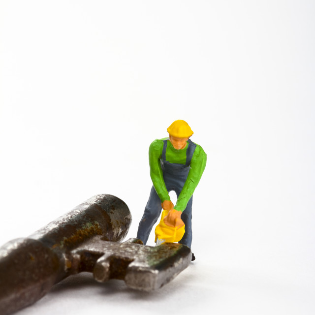"""Miniature figure workman with a chain saw"" stock image"