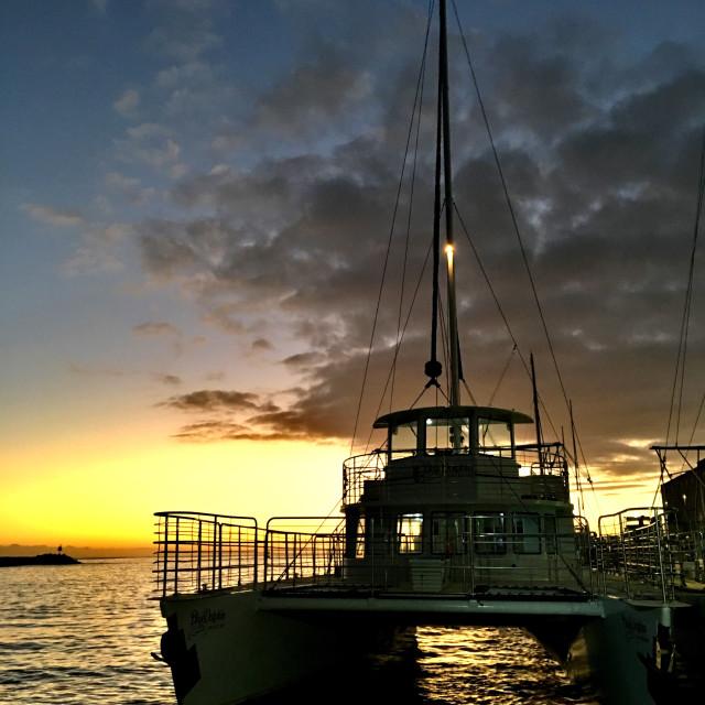 """Sailboat at sunset"" stock image"