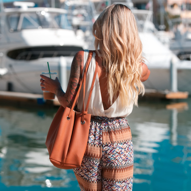 """""""High-end woman walks to yacht"""" stock image"""