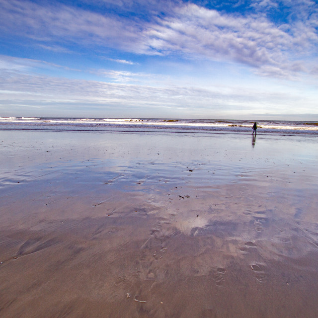 """""""Whitby, UK, Beach, Lone Walker and Reflection. Blue Sky and Copy Space."""" stock image"""