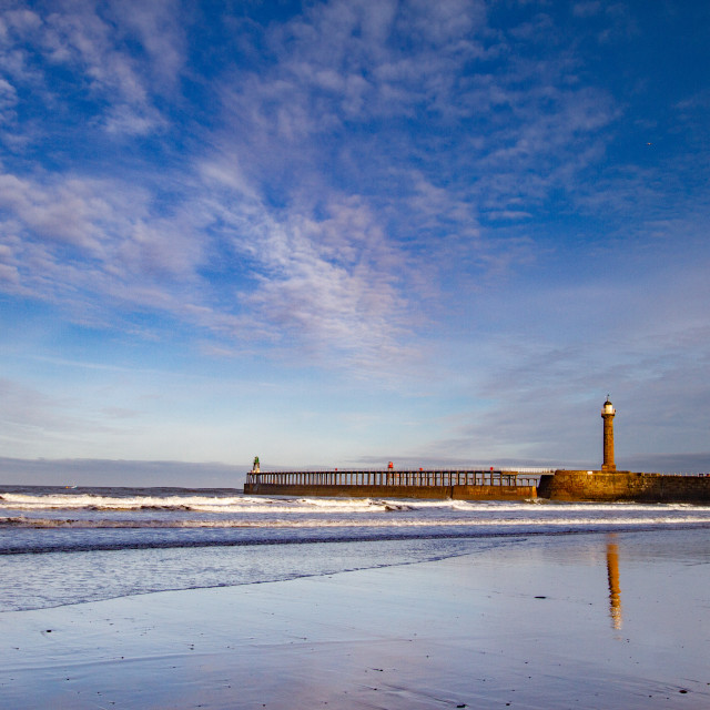"""""""Whitby, UK, Beach, Pier,lighthouse and Reflection. Blue Sky and Copy Space."""" stock image"""