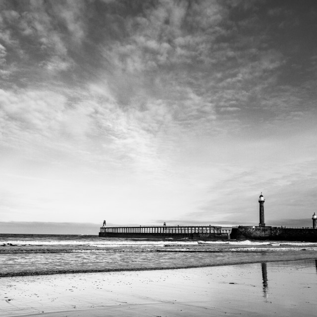 """""""Whitby, UK, Beach, Pier,lighthouse and Reflection. Monochrome and Copy Space."""" stock image"""