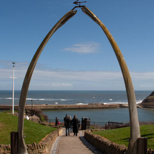 """""""Whitby,UK,Yorkshire,East coast, Monument, the Whalebone Arch. With pier and sea in the background."""" stock image"""