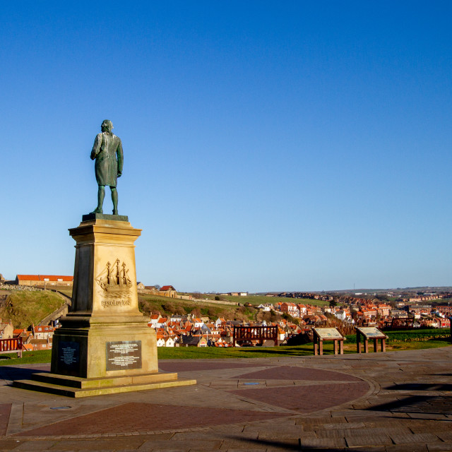 """""""Whitby,UK,Yorkshire,East coast, Monuments, Captain Cook Statue and the Whalebone Arch. Whitby Abbey in the Background"""" stock image"""