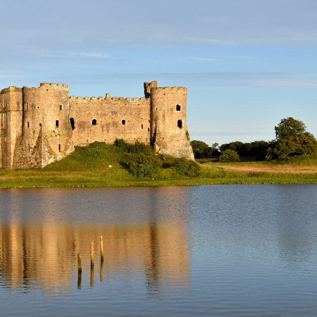 """""""A view of Carew Castle on a July evening."""" stock image"""