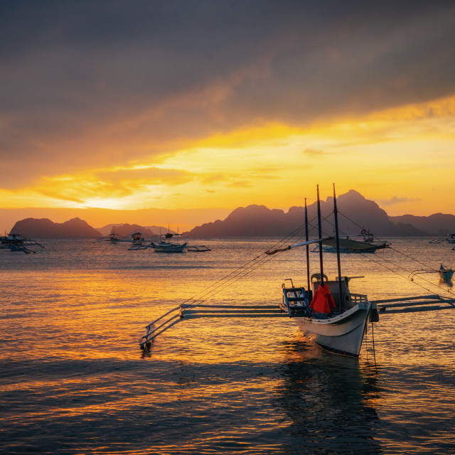 """Traditional philippine boats in El Nido at sunset lights, Philippines"" stock image"