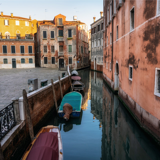 """""""Venice cityscape with narrow canal, moored boats and ancients colorful buildings, Italy"""" stock image"""