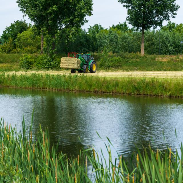 """Harvesting bales of hay 4"" stock image"