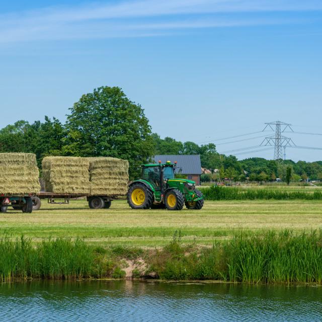"""Harvesting bales of hay 2"" stock image"