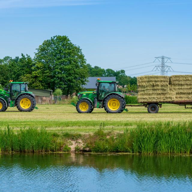"""Harvesting bales of hay 1"" stock image"