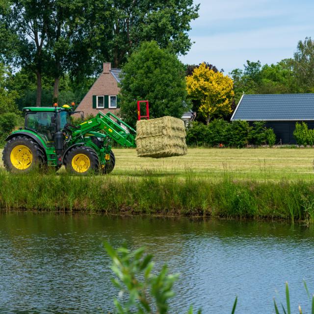 """Harvesting bales of hay 6"" stock image"