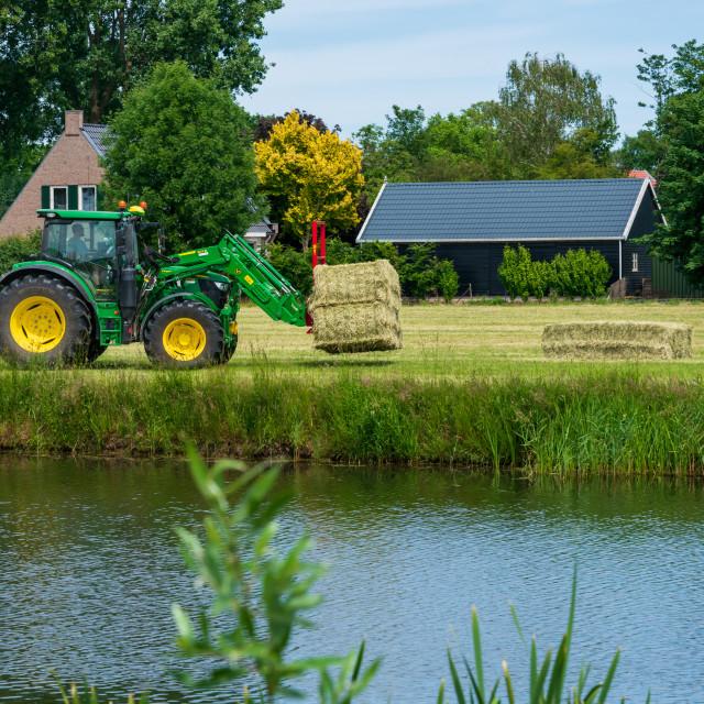 """Harvesting bales of hay 7"" stock image"