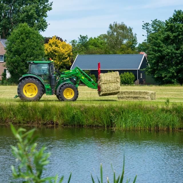 """Harvesting bales of hay 8"" stock image"