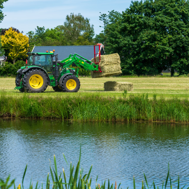 """Harvesting bales of hay 9"" stock image"