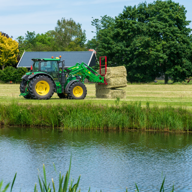 """Harvesting bales of hay 10"" stock image"