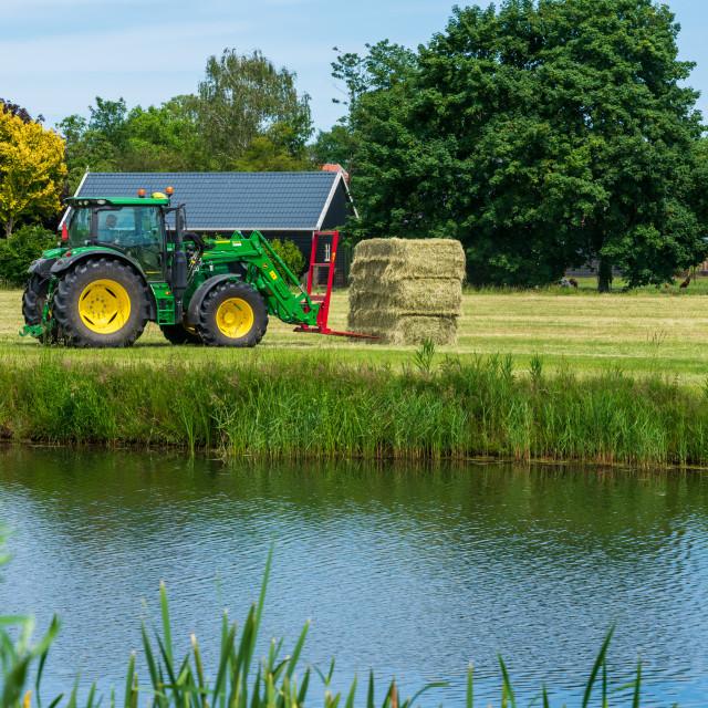 """Harvesting bales of hay 11"" stock image"