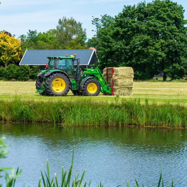 """Harvesting bales of hay 12"" stock image"