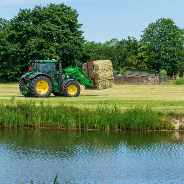 """Harvesting bales of hay 14"" stock image"
