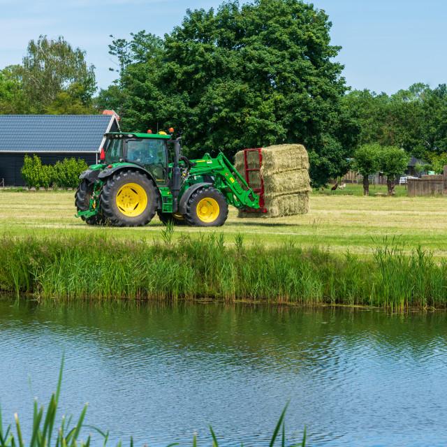 """Harvesting bales of hay 13"" stock image"