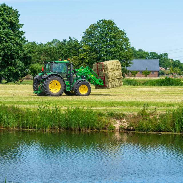 """Harvesting bales of hay 15"" stock image"