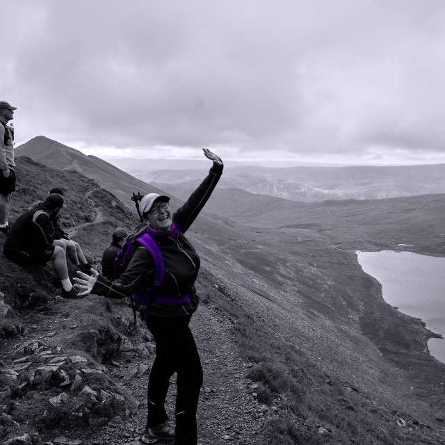 """""""A woman waving at the camera on Swirral Edge, Helvellyn"""" stock image"""