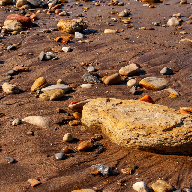 """""""Whitby, UK, Yorkshire East Coast, Pebble Assortment and Small Rock on the Beach"""" stock image"""