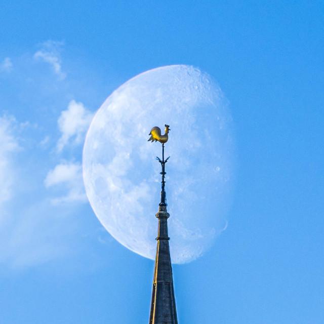 """""""Moonset, Sunrise on Spire of the Catholic Church, Cambridge UK."""" stock image"""