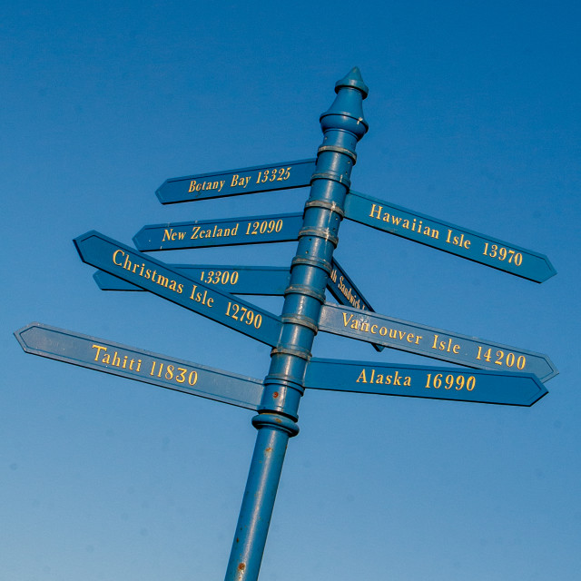 """Whitby,UK,Yorkshire,East coast, Captain James Cook World Destinations Blue Signpost on West Cliff."" stock image"