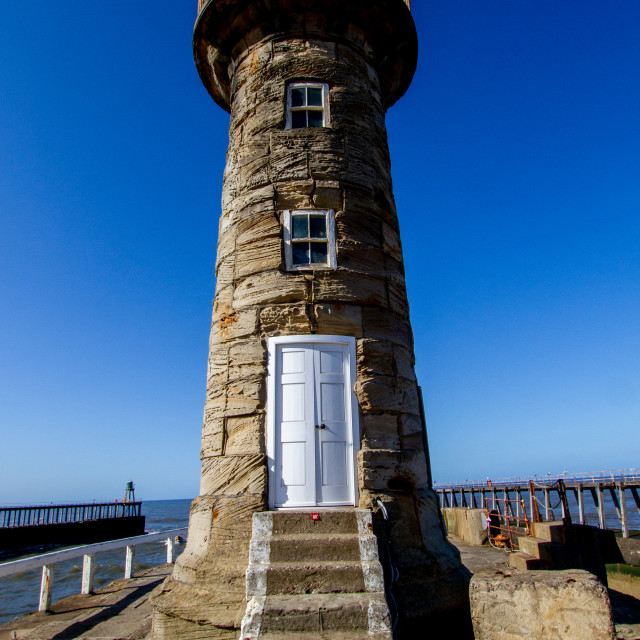 """Whitby,UK,Yorkshire,East coast, East Pier Old Lighthouse."" stock image"