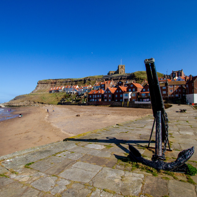 """""""Whitby,UK,Yorkshire,East coast, Old Anchor on Tate Hill Pier. St Mary's Church in the Background."""" stock image"""