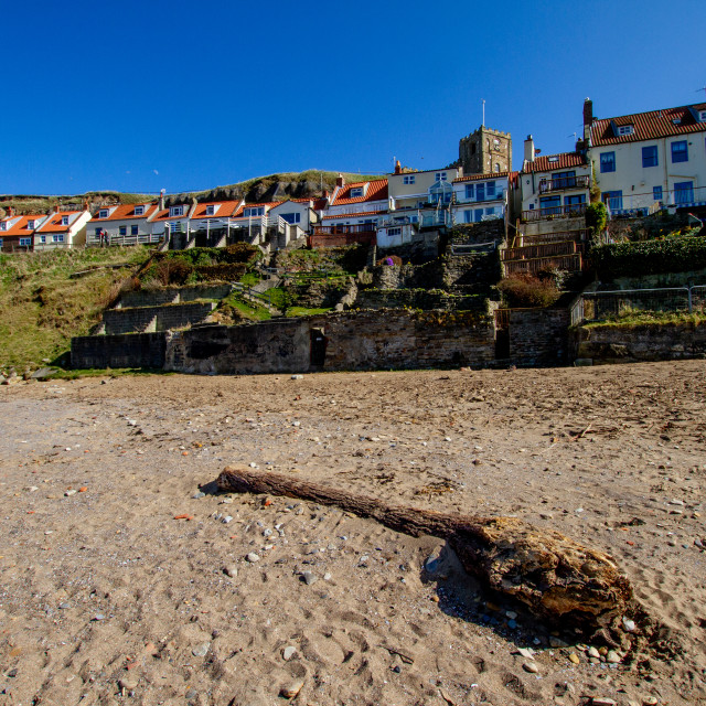 """""""Whitby,UK,Yorkshire,East coast, Collier Hope Beach and Driftwood, Tiered Gardens and St Mary's Church in the Background. Photographed April 2013."""" stock image"""