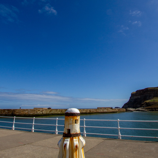 """""""Whitby,UK,Yorkshire,East coast, White Capstan on the Harbour Wall"""" stock image"""