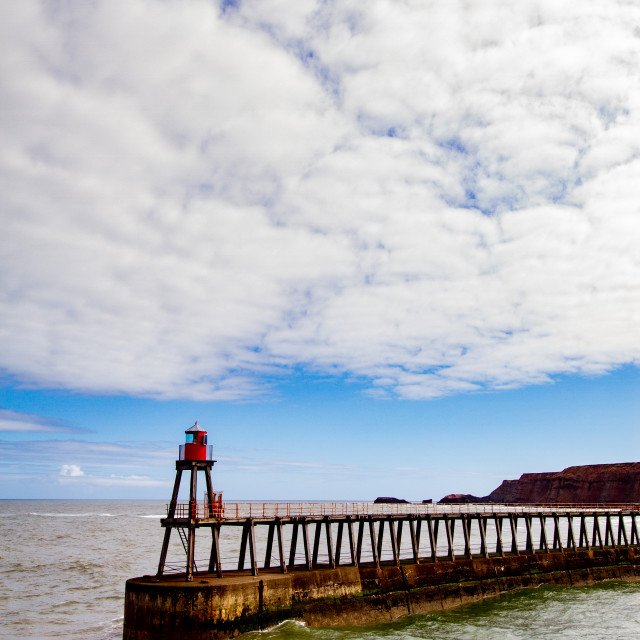 """""""Whitby,UK,Yorkshire,East coast, East Pier Breakwater and Harbour Light."""" stock image"""