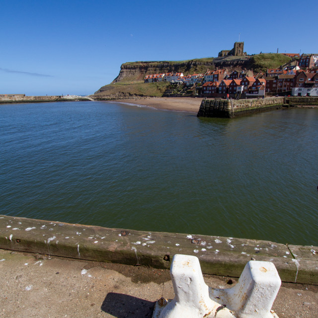 """""""Whitby,UK,Yorkshire,East coast, View across the Lower Harbour towards Tate Hill Pier and Sands. St Mary's Church in the background, ship Mooring Bollard in the Foreground. Photograph taken on a sunny day, April 2013"""" stock image"""