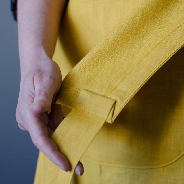 """Fabric Apron against plain background"" stock image"