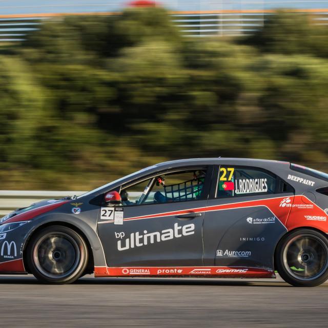 """A Honda Civic race car speeding along at Estoril Racetrack"" stock image"