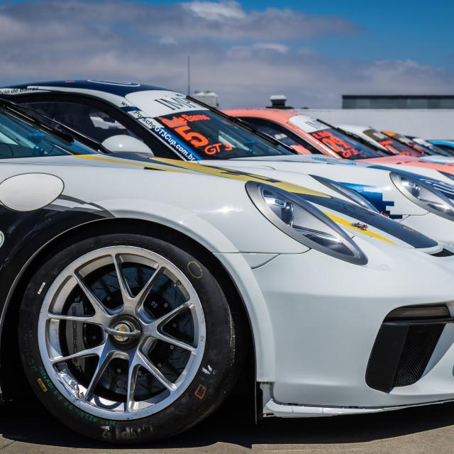 """""""Line-up of Porsche race cars at Estoril Racetrack"""" stock image"""