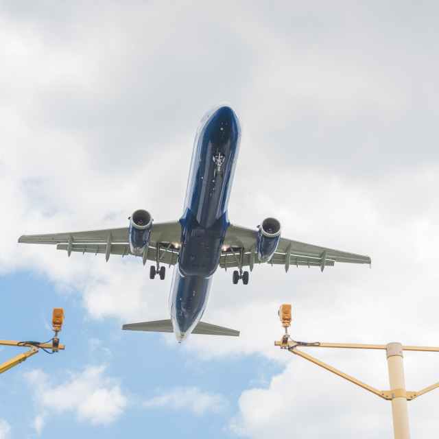 """passenger jet landing at an airport"" stock image"