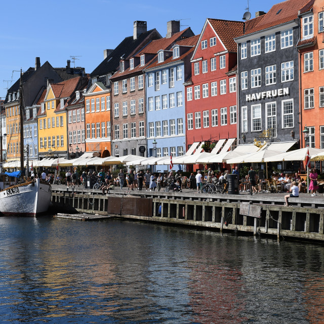 """Tourists are back to Denmark and view of Nyhavn canal"" stock image"