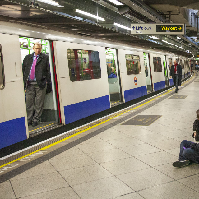"""London Underground - Man with Dog"" stock image"
