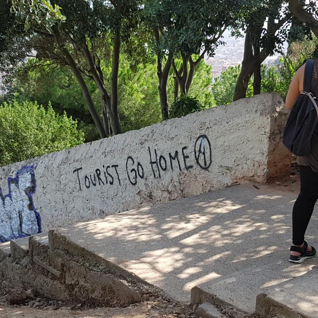 """""""""""Tourist Go Home"""" Graffiti in Barcelona"""" stock image"""