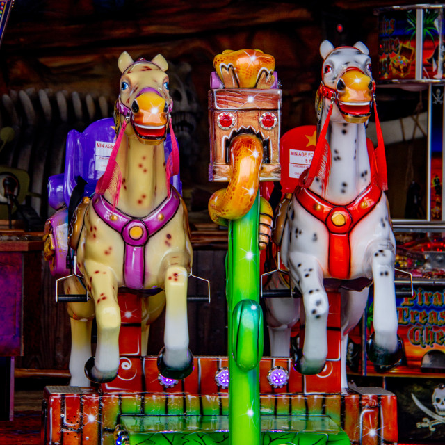 """""""Colourful Coin Operated Horse Ride in Whitby Amusement Arcade on Yorkshire East Coast."""" stock image"""