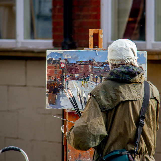 """""""Artist Painting a Coastal Scene Using an Assortment of Brushes."""" stock image"""