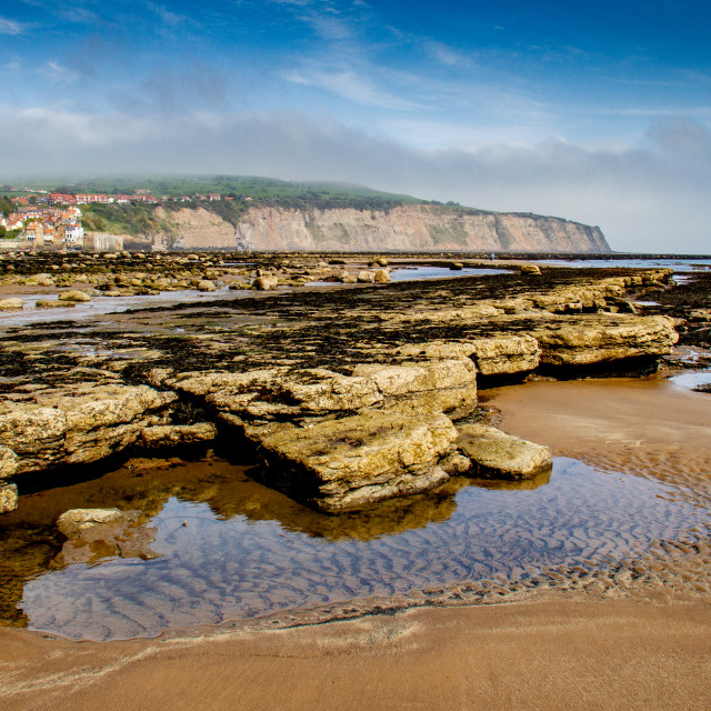 """Robin Hoods Bay, Yorkshire East Coast Fishing Village Shrouded in Mist, Rockpools to the Foreground."" stock image"