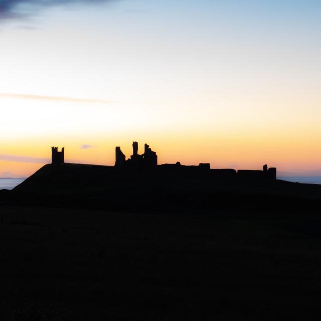"""Last Light, Dunstanburgh Castle Northumberland"" stock image"
